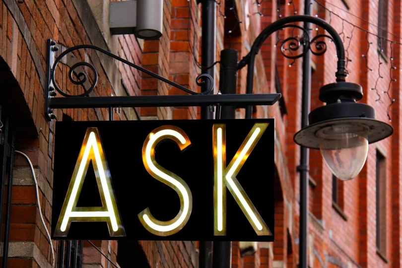 """street sign with the word """"Ask"""""""
